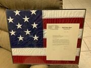 A Framed United States Flag Flown Over The Capitol Building In Washinton D.c