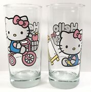 Sanrio Hello Kitty Drinking Glasses Lot Of 2 Easel Artist And Bike Rider Unused