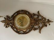 Vintage Syroco Scrolling Goldtune Wall Clockwith German Empire 8 Day Movement
