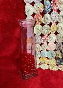 Pink Colored Glass Bud Vase With Red Faux Glass Heart Shapes