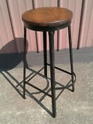 Antique Tall Black Metal Bar Stool With Round Wooden Seat And Foot Rest 1920s