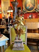 Tall Italian Baroque Style Carved And Giltwood Figurative Candleholder