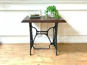 Antique Singer Sewing Machine Table Black Cast Iron Base With Later Wooden Top.