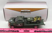 The Menards U.s. Army Mack Truck With Flatbed With Military Jeep
