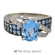 Oval Topaz Ring With Overpass Design Of Diamonds