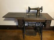 1910 Vintage Singer Red Eye Sewing Machine With Oak Cabinet. Has Belt And Works.