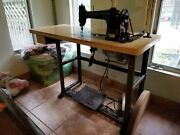 Vintage Singer Sewing Machine With Foot Pedal, Lamp, And Table.