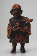 Antique Japanese Netsuke Of A Travelling Monk Holding A Puppy Or Kitten Unsigned