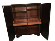 Antique Dark Cabinet With Many Drawers And Shelves