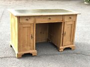 Pine Desk. Green Leather Top Drawers And Cupboards.