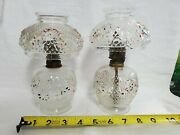 Two Antique Clear Glass Cosmos Miniature Oil Lamps