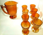 Vintage Jeanette Iridescent Marigold Carnival Crackle Glass Pitcher And 8 Tumblers