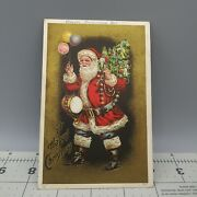 A Happy Christmas Embossed Vintage Santa Claus With Balloons Post Card 909