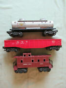 Lionel 6465 Sunoco Tank Car, 6462 Red Nyc Gondola, And 6017 Brown Caboose