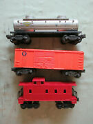 Lionel 2465 Sunoco Tank Car, X1004 Baby Ruth Boxcar And Unnumbered Caboose