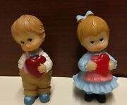 Valentine Boy And Girl Figurines, Each Holding A Heart