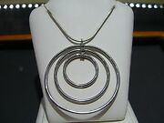 Movado 18 Karat White Gold Diamond And Sterling Silver Pendant Necklace Circle