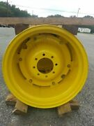 Two New 15x24 John Deere Part Re220950 Tractor Wheels With 8 On 8 Centers