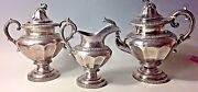 An American 19th Century 3 Piece Coin Silver Tea Set By J. And I. Cox New York