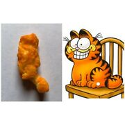 Garfield The Cat Shaped Cheeto. Perched With Long Tail