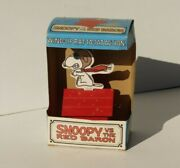 1960s Chein Snoopy Vs. The Red Baron Wind Up Pilot Snoopy Flying His Dog House
