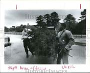 1991 Press Photo James Held And Ronald Teamer Unload Christmas Trees In Houston.