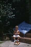 35mm Slide 1950s Red Border Kodachrome Boy Playing On Stairs Of House