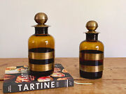 Pair Of Giant Vintage Amber Glass Bottles With Brass Rings And Tops