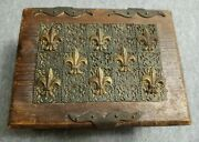 Antique Wooden Jewelry Box With An Metal Decoration.