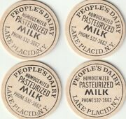Lot Of 4 Milk Bottle Caps. People's Dairy. Lake Placid, Ny.