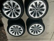 Lightly Blemished Tesla 20 Aluminum Silver Rims With Wheel And Tire Caps.
