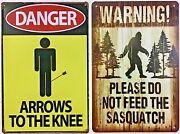 Two 8x12 Tin Signs Funny Danger Warning Arrows Sasquatch Bigfoot Feed Man Cave