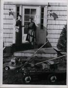 Press Photo Boy Shows His Mother New Lawn Mower - Nea26174