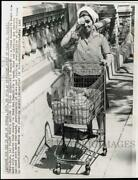 1965 Press Photo Cuban Housewife With Familyand039s Rationed Weekand039s Groceries