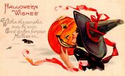 Vintage Stecher Litho Co. Beautiful Sexy Witch Holding A Jol Halloween Postcard