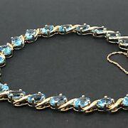 10k Blue Topaz Bracelet With Safety Chain 7inches