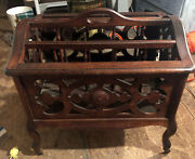 Antique English Wood Carved Magazine Rack With Original Wooden Wheels. Large