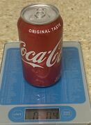 Factory Sealed, Unopened Empty Coke Can