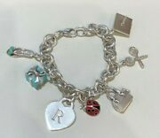 And Co. Sterling Silver And Enamel Charm Bracelet With 7 Charms