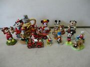 15 Disney Mickey Mouse Figurines And Snow Globes