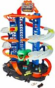 Hot Wheels City Ultimate Garage Track With 2 Die-cast Car Chasing T-rex