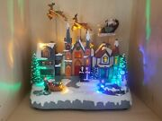 Eluceo In Motion Animated Musical Christmas Holiday Village Santa Reindeer