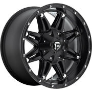 4- 18x9 Black Hostage D531 6x135 And 6x5.5 -12 Wheels Pro At 285/65/18 Tires