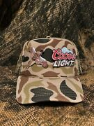 Pheasant Hunting X Coors Light Patches On A Camo Rope Brim Trucker Hat