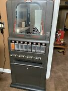 1940andrsquos Coin Candy Machine Antique