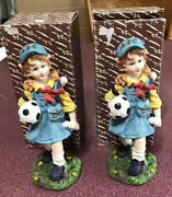 A Pair Of 8 Inch Tall Poly Resin Statues Of A Little Girl Holding A Soccer Ball