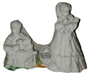 2 Department 56 Silhouette Winter Figures Girl With Baby And Boy With Train
