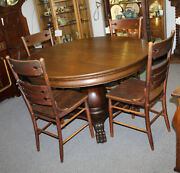 Antique Oak Round 48andprime Diameter Dining Table With 4 Leaves Andndash Claw Feet