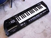 Roland Ax-09 Lucina Shoulder Synthesizer Black W / Ac Adapter Strap