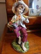 Unmarked Boy Holding Basket Of Fruits And Bird Figurine